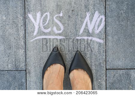 Businesswoman in black shoes, deciding where to go, yes or no