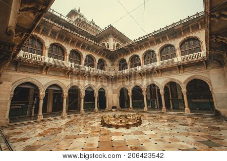 JAIPUR, INDIA - JAN 22, 2016: Courtyard of historical Albert Hall Museum with arches and columns on January 22, 2016. Indo-Saracenic architecture building was opened in 1887.