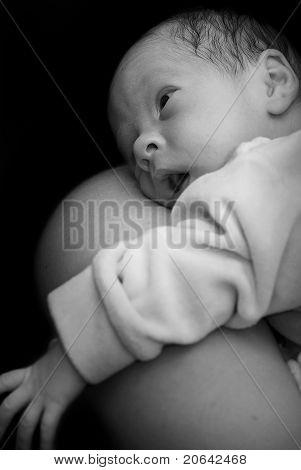 Newborn On Mothers Shoulder