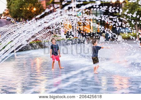 Washington Dc, Usa - August 4, 2017: Young Boys Children Playing In Water Fountain In Georgetown Wat