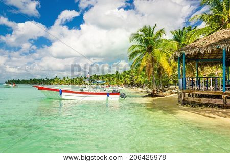Amazing Caribbean coast with moored motorboat, Dominican Republic, Caribbean Islands, Central America
