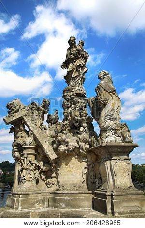 Statuary of the Madonna and St. Bernard on the Charles Bridge (Karluv Most) in Prague Czech Republic