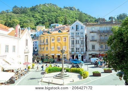 Sintra, Portugal - August 8, 2017: Aerial view of the Old pelourinho or column of punishment and Castle of the Moors on top of a hill above Sintra in Historic Center, Unesco World Heritage Site.