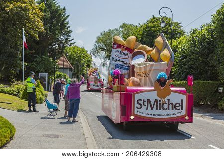 Sainte Marguerite sur Mer France - July 09 2015: St. Michel Madeleines Caravan during the passing of Publicity Caravan before the stage 6 of Le Tour de France 2015 on 09 July 2015. St. Michel Madeleines is a producer of traditional French sponge cakes.
