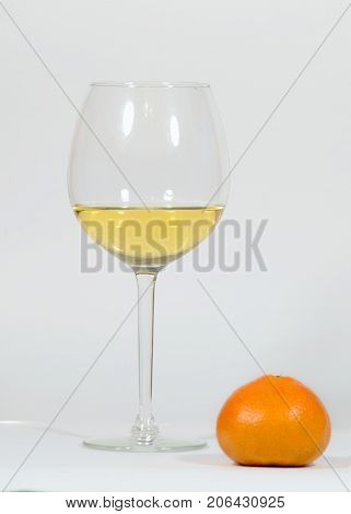 Festive Christmas still life.Festive Christmas still life.Glasses with wine on a white background.