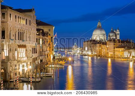 Basilica Santa Maria della Salute Punta della Dogona and Grand Canal at blue hour sunset in Venice Italy with reflections