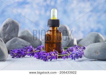 bottle of lavender massage oil - beauty treatment