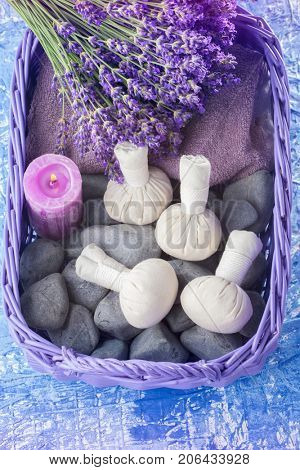 basket of thai herbal compress massage - beauty treatment