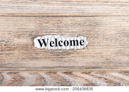 WELCOME text on paper. Word WELCOME on torn paper. Concept Image.