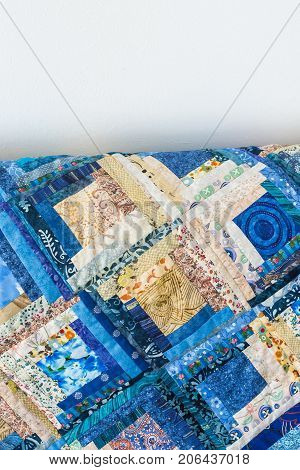 handmade, creation, sewing, fabrics concept - lots of different cotton patches in various style with interesting floral design sewed together in colorful blanket. there is white empty space for text