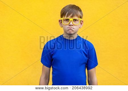 Angry, Aggressive Concept. Handsome Young Boy Looking At Camera With Angry Face .