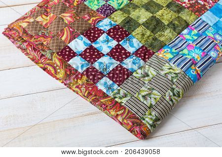 arts and crafts, handmade, sewing, quilting, interior, cosiness, culture, applique concept - colorful textile work made of bright rags in popular american technique patchwork