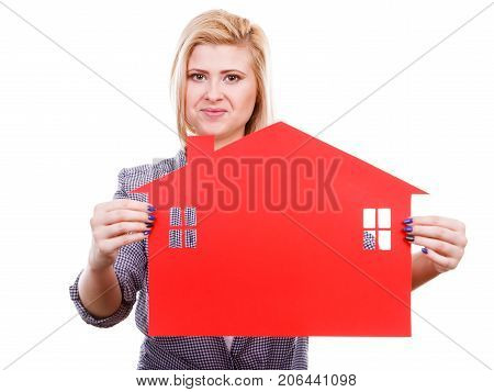 Ownership property real estate concept. Blonde girl holding red paper house symbol. New flat apartment. Isolated on white