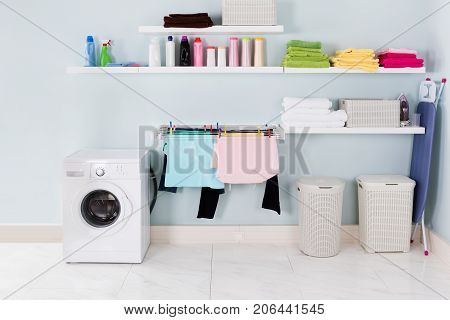 Interior Of Utility Room With Washing Machine And Cleaning Equipment