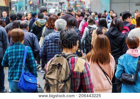 Crowds Of People Crossing A Road In Hong Kong