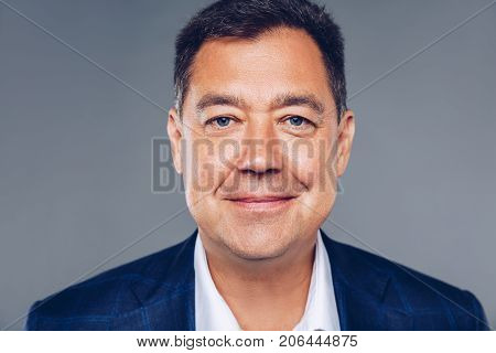 Credible Mature Confident Business Man On Suit And White Shirt,dressed Well Studio Portrait.