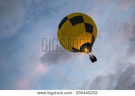 Bristol, UK: August 13, 2016: Flying a balloon at the Bristol International Balloon Fiesta. The annual event has become Europe's largest hot air balloon festival.