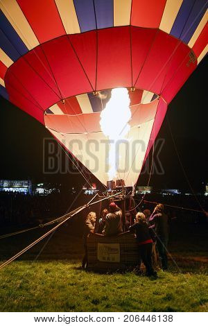 Bristol, UK: August 11, 2016: Night Glow at the Bristol International Balloon Fiesta where the balloons light up in time to the music. The annual event has become Europe's largest hot air balloon festival.