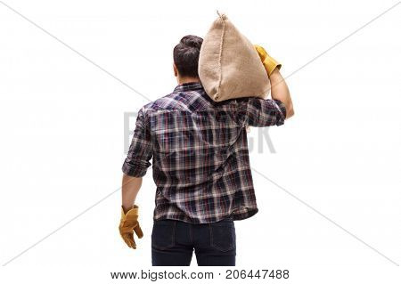 Rear shot of a farmer with a burlap sack isolated on white background