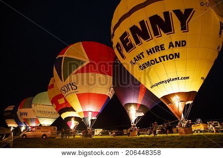 Bristol, UK: August, 2016: Night glow at the Bristol International Balloon Fiesta. The balloons light up in time to the music. The annual event has become Europe's largest hot air balloon festival.