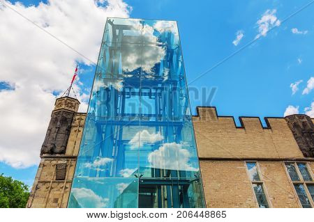 Historical Guerzenich In The Old Town Of Cologne, Germany, With Modern Glass Elevator