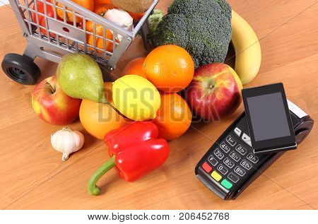 Payment Terminal And Mobile Phone With Nfc Technology, Fruits And Vegetables