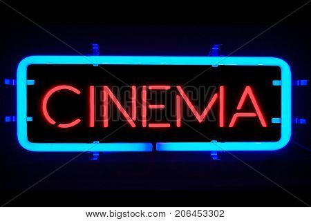 3D rendering flickering blinking blue neon sign on black background cinema movie film entertainment sign concept