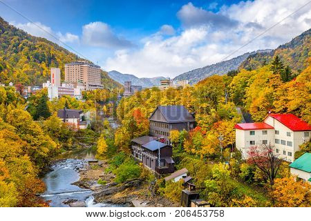 Jozankei, Hokkaido, Japan inns and river skyline during the autumn season.