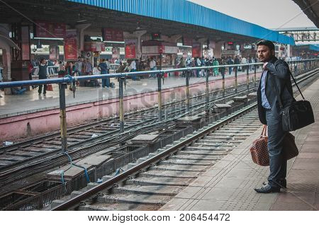 Ajmer India : 18th February 2015 - Shot of an Indian in formal attire waiting anciously for the train to arrive.