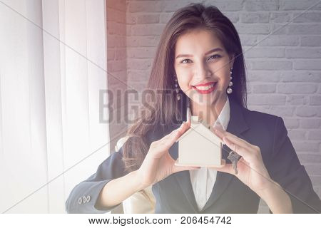 young woman working at Housing company housing business concept