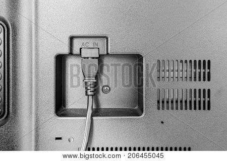 Closeup View Of Power Cable Plug Into The Television Input