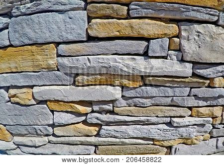Stone wall made of flagstone, building stone, dimensional stone.