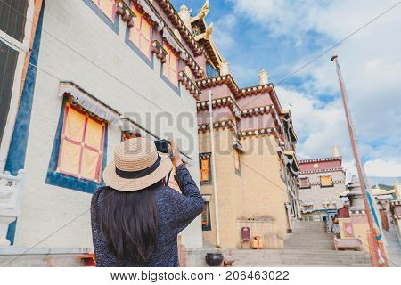 Female tourists are traveling in Little Potala Palace Lamasery The famous temple in shangri-la yunnan china.
