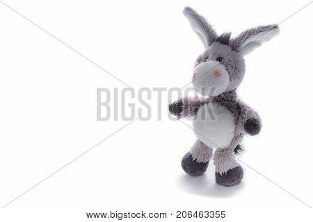 Grey plush toy donkey isolated on white
