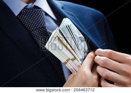 Concept for corruption finance profit bail crime bribing fraud auction bidding Bundle of dollar cash in hand