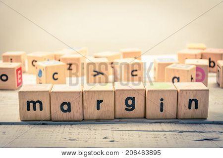 Word ' margin ' wood Cubic on the wood