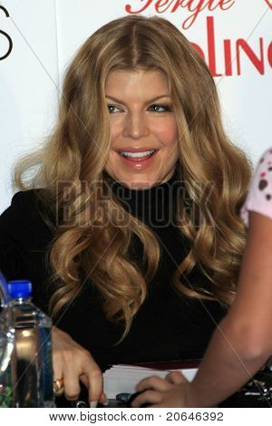 COSTA MESA - DEC 8: Stacy Ferguson aka Fergie launches her handbag collection for Kipling and signs autographs for her fans at Macy's in Costa Mesa, California December 8, 2007.