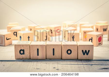 Word ' allow ' wood Cubic on the wood