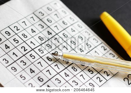 Crossword Their Numbers And Yellow Handle