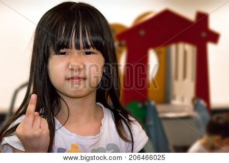 A Mean Young Girl Showing Offensive Gesture