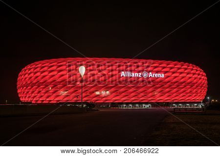 MUNICH GERMANY - 26 SEPTEMBER 2017: Allianz Arena the football stadium of FC Bayern illuminated in red at night