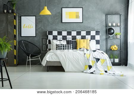 Spacious Bedroom With Yellow Accessories