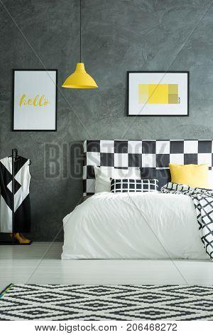 Geometric Carpet In Dark Bedroom