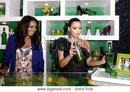 WEST HOLLYWOOD, CA - MAY 10: LaLa Vasquez, Kim Kardashian at the Midori Melon Liqueur Trunk Show at Trousdale on May 10, 2011 in West Hollywood, California