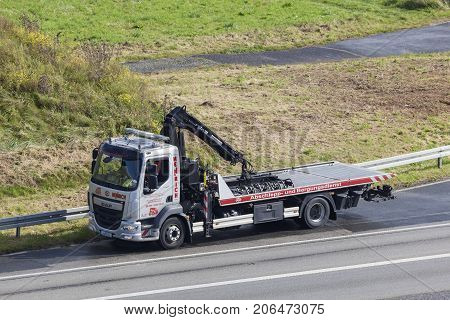 Frankfurt Germany - Sep 19 2017: DAF LF tow and wrecking truck on the highway in Germany
