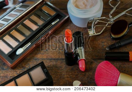 set of cosmetics on old wood background