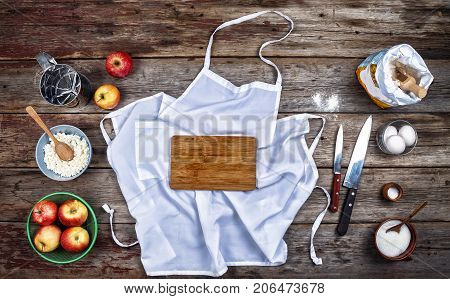 Concept: Cooking, Baking. Kitchenware And A Variety Of Products For Baking Close Up On A Rustic Tabl