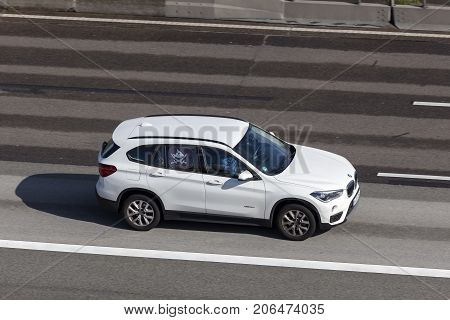 Frankfurt Germany - Sep 19 2017: White BMW X1 compact luxury crossover SUV driving on the highway in Germany