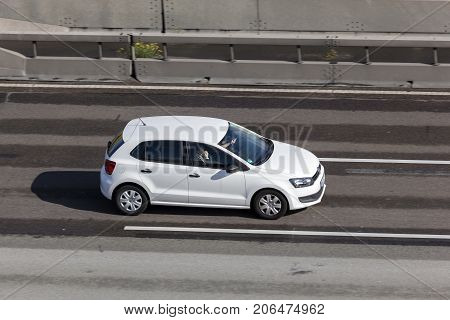 Frankfurt Germany - Sep 19 2017: White Volkswagen Polo supermini car driving on the highway in Germany