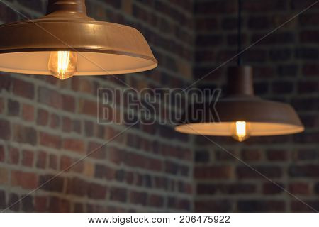 Vintage lamps with retro lamps on a brick wall background in a loft